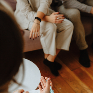 couple on a couch speaking with therapist